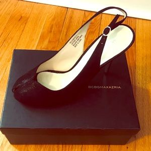BCBG Sling back peep toe with silver heel.